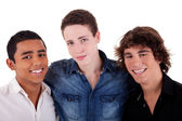 Friends: three young man of different colors,looking to camera and smiling, isolated on white, studio shot — Stock Photo