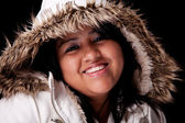 Portrait of a young latin woman with a furry hood — Stock Photo