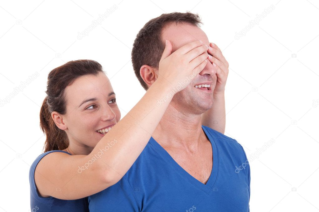 Portrait of a happy woman covering his man eyes, to surprise him — Foto Stock #9896716