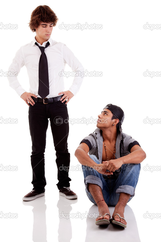 Two men of different ethnicity, one sitting looking at the other standing, isolated on white, studio shot — Stock Photo #9896823