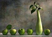 Still life with vase and green apples — Stock Photo