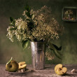 Still life with a bouquet and apple — Stock Photo