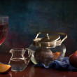 Still-life with plums and a glass of wine - Stock Photo