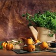 Still life with a teapot, parsley and apples - Stock Photo
