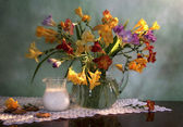 Still life with flowers and milk — Stock Photo