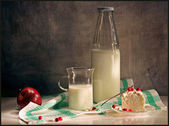 Still Life with a bottle of milk — Stock Photo