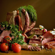 Still Life with sausage and greens - Stock Photo