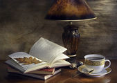 Still Life with a book and a lamp — Stock Photo