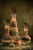 Still Life with spices in glass flasks — Stock Photo