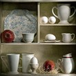 Shelf with white dishes — Stock Photo