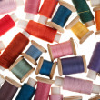 Background of bobbins of thread - Stock Photo