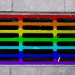 Multi-coloured storm drain — Stock Photo