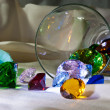 Overturned glass with colour gems — Stock Photo