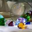 Stock Photo: Overturned glass with colour gems