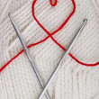 Heart from a woolen string - Stock Photo