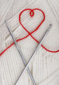 Heart from a woolen string — Stock Photo