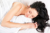 Cute woman sleeping on the white bed — Stock Photo