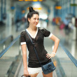 Young pretty woman in the airport — Stock Photo