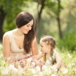 Mother communicate with daughter in park — Stock Photo #10723915