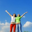 Two happy young women dreams to fly on winds — Stock Photo #9247511