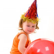 Happy girl playing with colorful balloons — Stock Photo