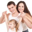 Happy mother, father and daughter playing on the white backgroun — Stock Photo