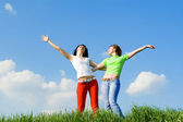 Two happy young women dreams to fly — Stock Photo