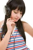 Young woman in earphones — Stock Photo