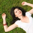 Stock Photo: Sweet woman rest on the grass