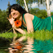 Pretty woman rest in the park with flower — Stock Photo
