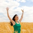 Happy woman in golden wheat — Stock Photo #9251247
