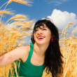 Happy woman in golden wheat — Stock Photo #9251257