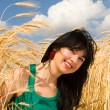 Happy woman in golden wheat — Stock Photo #9251261