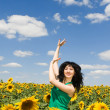 Fun woman dance in the field of sunflowers — Stock Photo