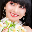 Pretty woman portrait with flowers — Stock Photo
