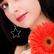 Young woman with red flower — Stock Photo