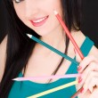 Stock Photo: Young womwith varicolored pencils
