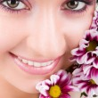 Stock Photo: Young woman with pink flowers