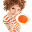 Fun woman eating caviar on the white background - Foto Stock