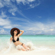 Happy fashion woman on the beach — Stock Photo #9252188
