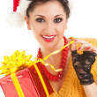 Fun santa woman with christmas gift - Stock Photo