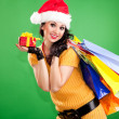 Fun santa woman with gift box and color packages - Stock Photo