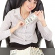 Elegant business woman with pile of money - Stock Photo