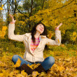 Young pretty woman on the autumn leaf — Stock Photo #9253481