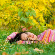 Young pretty woman rest on the autumn grass — Stock Photo #9253492