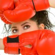 Pretty woman with red boxing glove — Stock Photo #9253522
