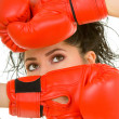 Pretty woman with red boxing glove - Stock Photo