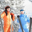 Happy women with skis in the winter landscape - Stock Photo