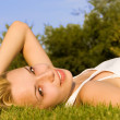 Sweet woman rest on the green summer grass — Stock Photo