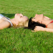Sweet women rest on the grass - Foto Stock